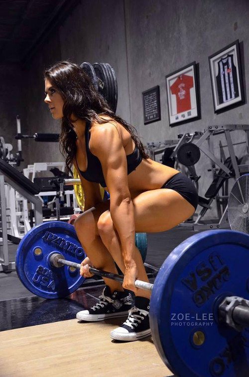 Image of Female Weight Lifter Squatting