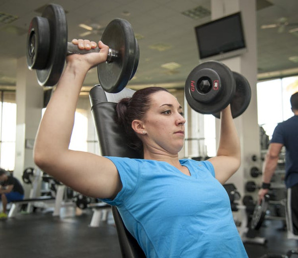 Woman doing Dumbbell Shoulder Press