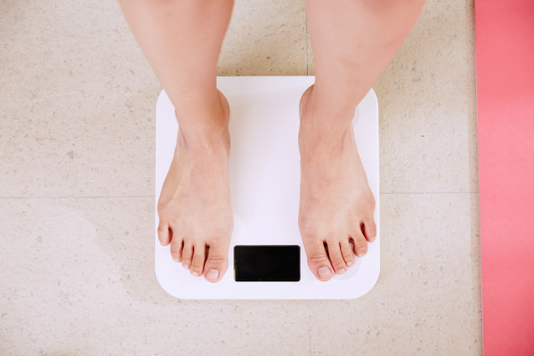 Weighing Self on Scale