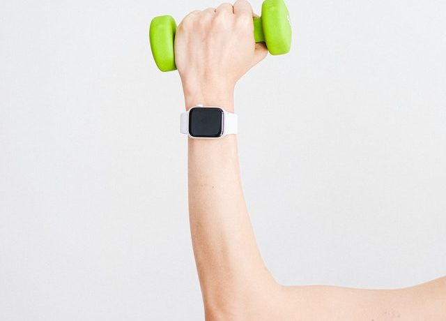 Woman Holding Dumbbell