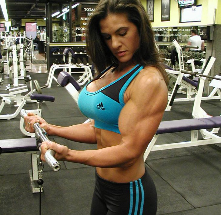 Woman training biceps